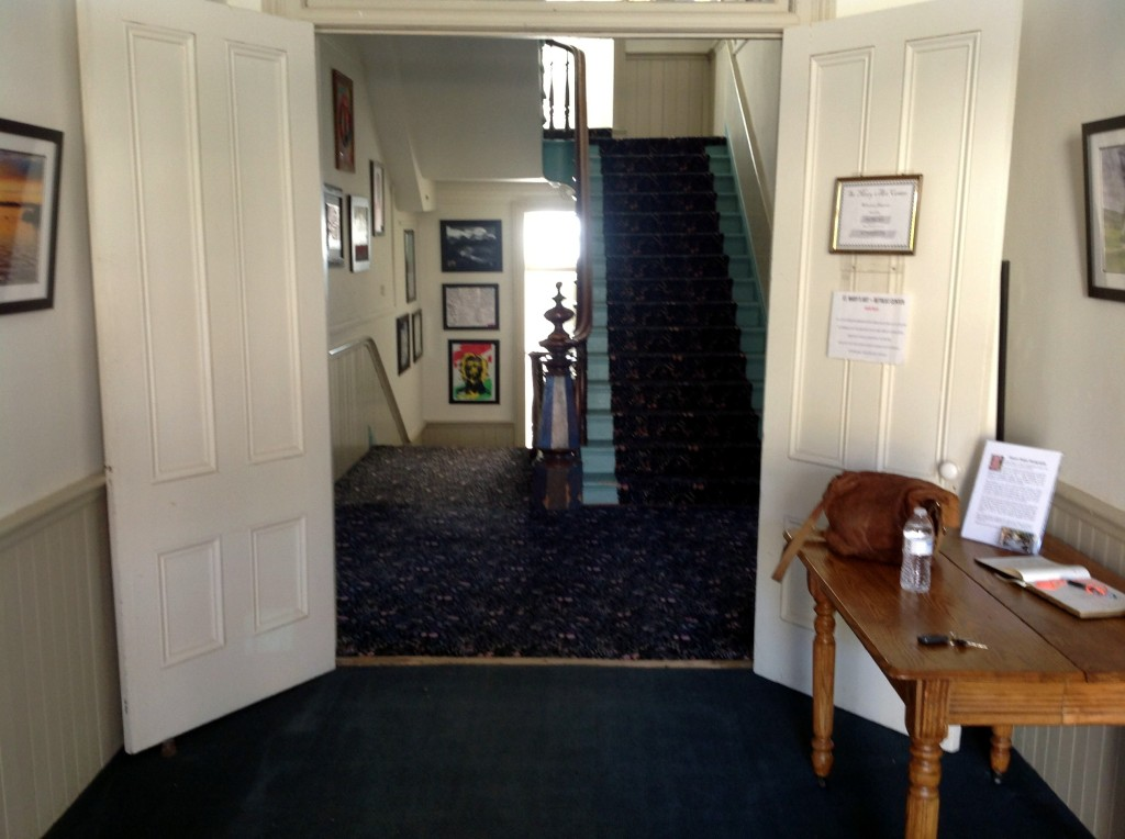 The Entry is on the middle floor with the workroom up one flight of stairs and the kitchen down one flight of stairs